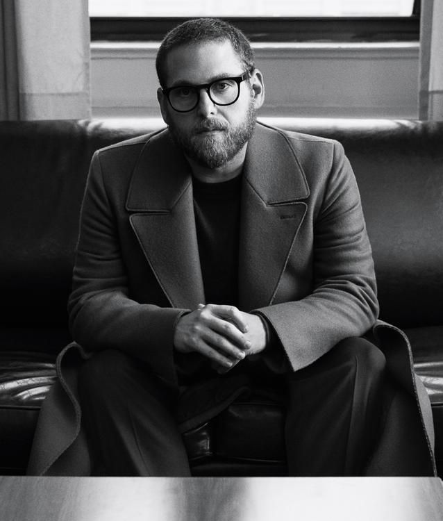 """CLOTHES MAKE THE MAN """"I do love fashion, and I do care about style,"""" Hill says. """"It's been amazing to have your style recognized. It's so personal."""" Ermenegildo Zegna coat, $6,950, Ermenegildo Zegna, 663 Fifth Avenue, New York, The Row sweater, $1,095, The Row, 17 East 71st Street, New York, Ami pants, $405, mrporter.com"""