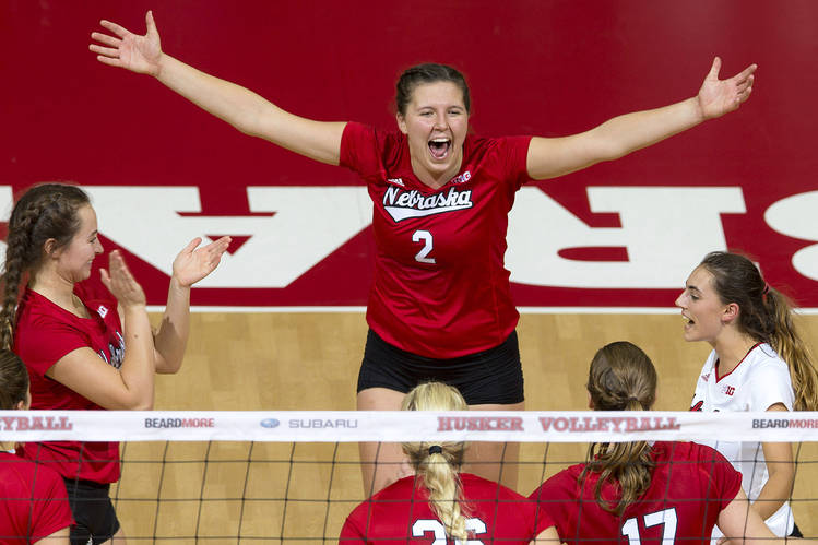 Mikaela Foecke, center, co-captain of the University of Nebraska women's volleyball team, has helped the Cornhuskers win two national titles in the past three years.