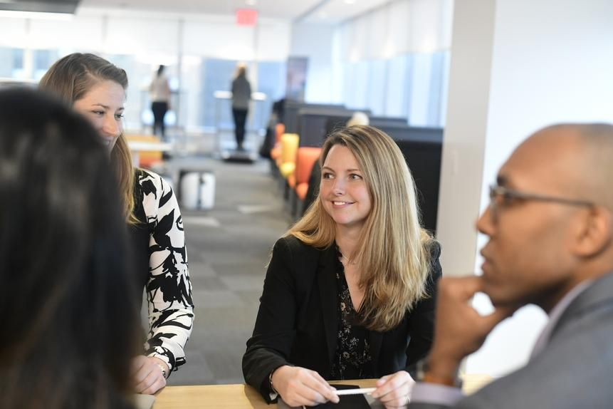 Julia Lamm, center, shown here meeting with one of the teams she oversees as a director at PricewaterhouseCoopers in New York, has built a strong internal network so she can delegate tasks quickly and prevent logjams.