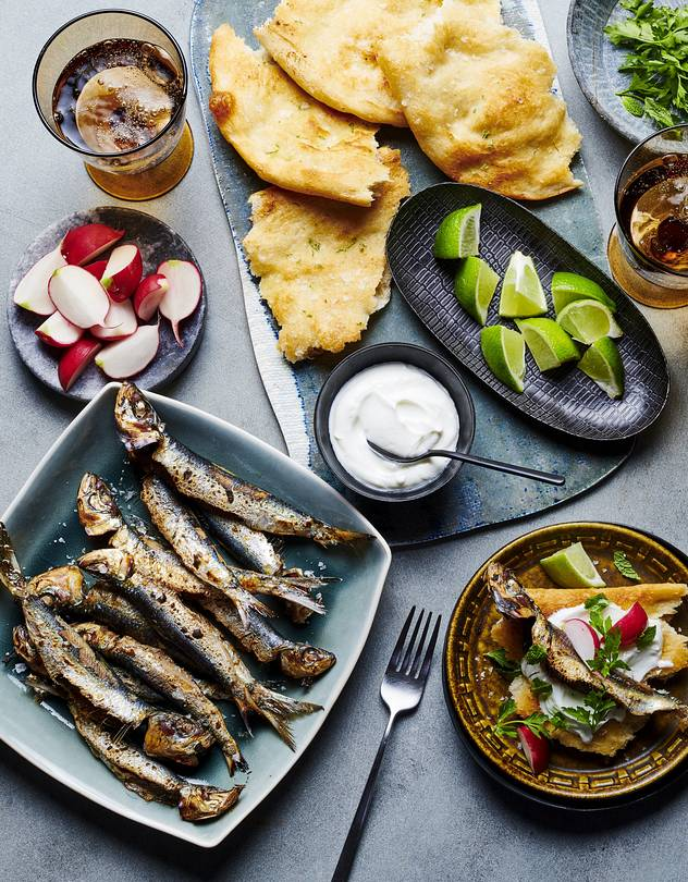 FIN ART Cooking the sardines whole preserves their succulence. Simply pull off pieces of fish to top the flatbread.