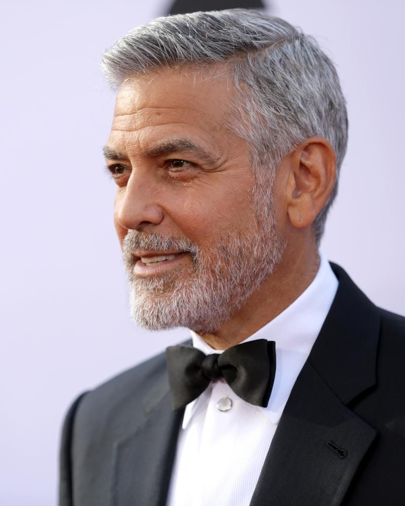 MR. SLATE George Clooney's salt-and-pepper coif is a look men's products aim to simulate.