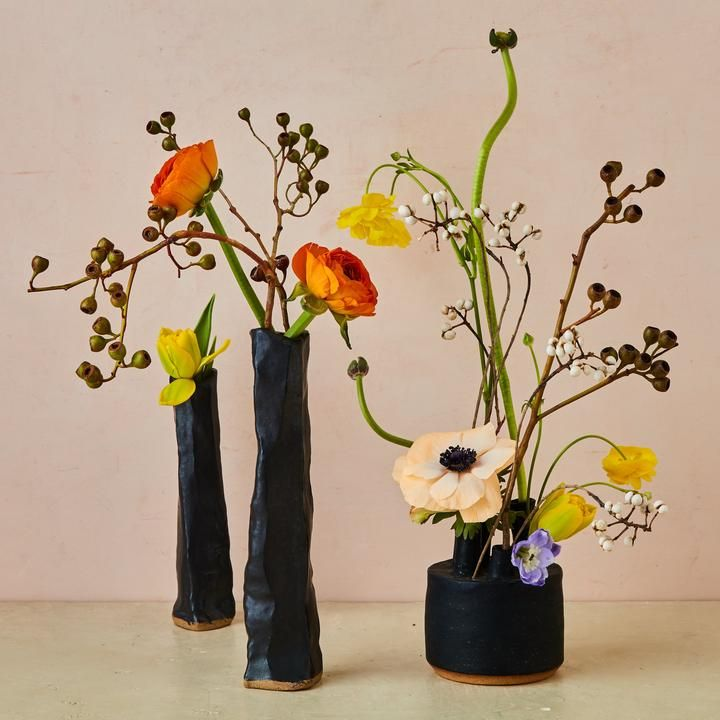 THE ARRANGEMENT Long stems of ranunculus mimic the whimsical lines in Joan Miró's 'The Hunter, Catalan Landscape' (1924). Near left: Ikebana Vessel, $225, mariteacosta.com; others, stylist's own.