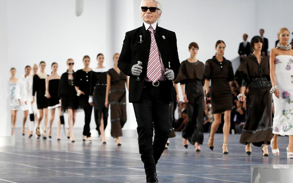 Karl Lagerfeld, seen walking the runway at the end of his spring 2013 ready-to-wear show for Chanel in October 2012, was an irreverent and energetic creator.
