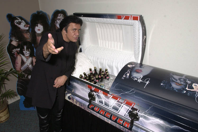 Gene Simmons with a KISS Kasket.