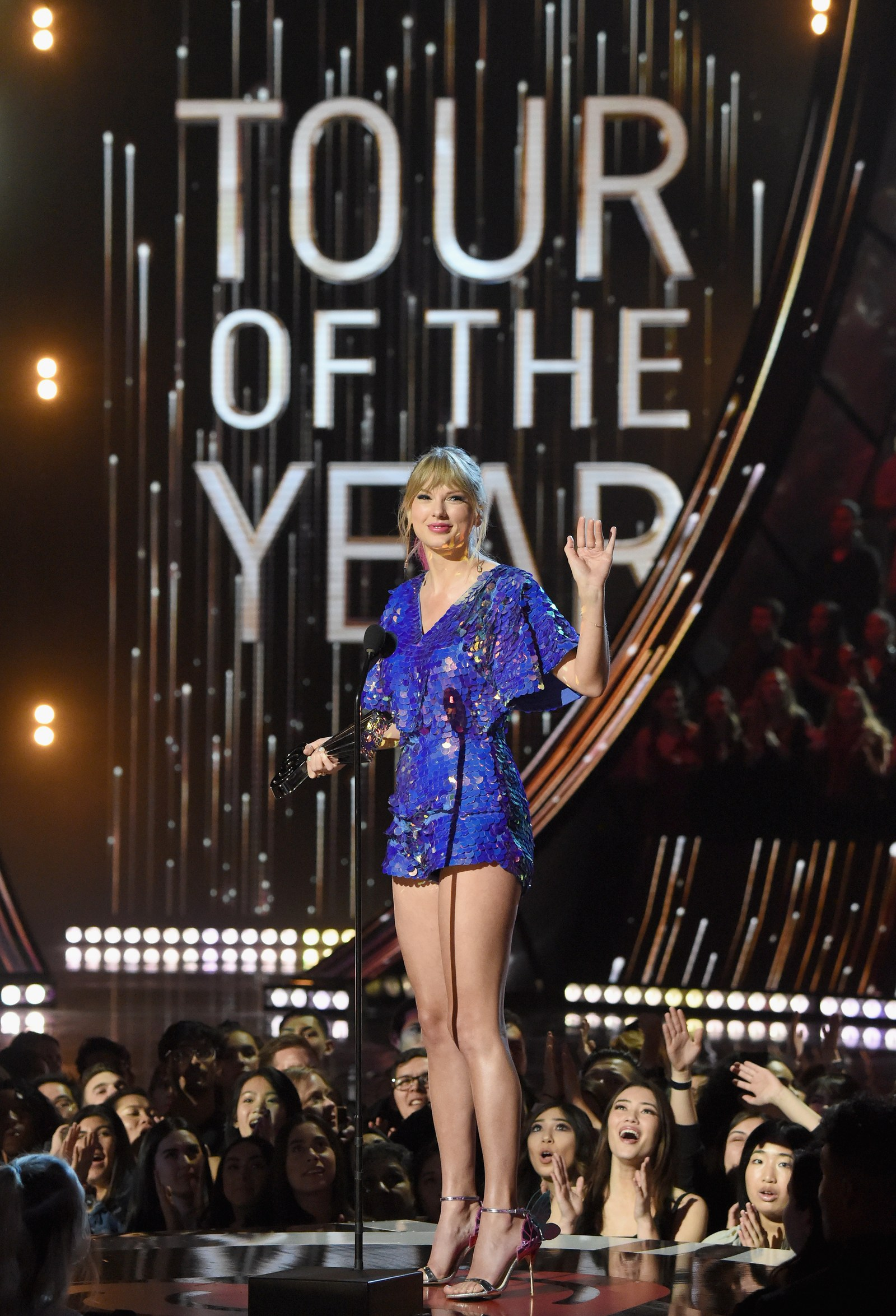 Taylor Swift accepts the Tour of the Year award at the iHeart Radio Music Awards