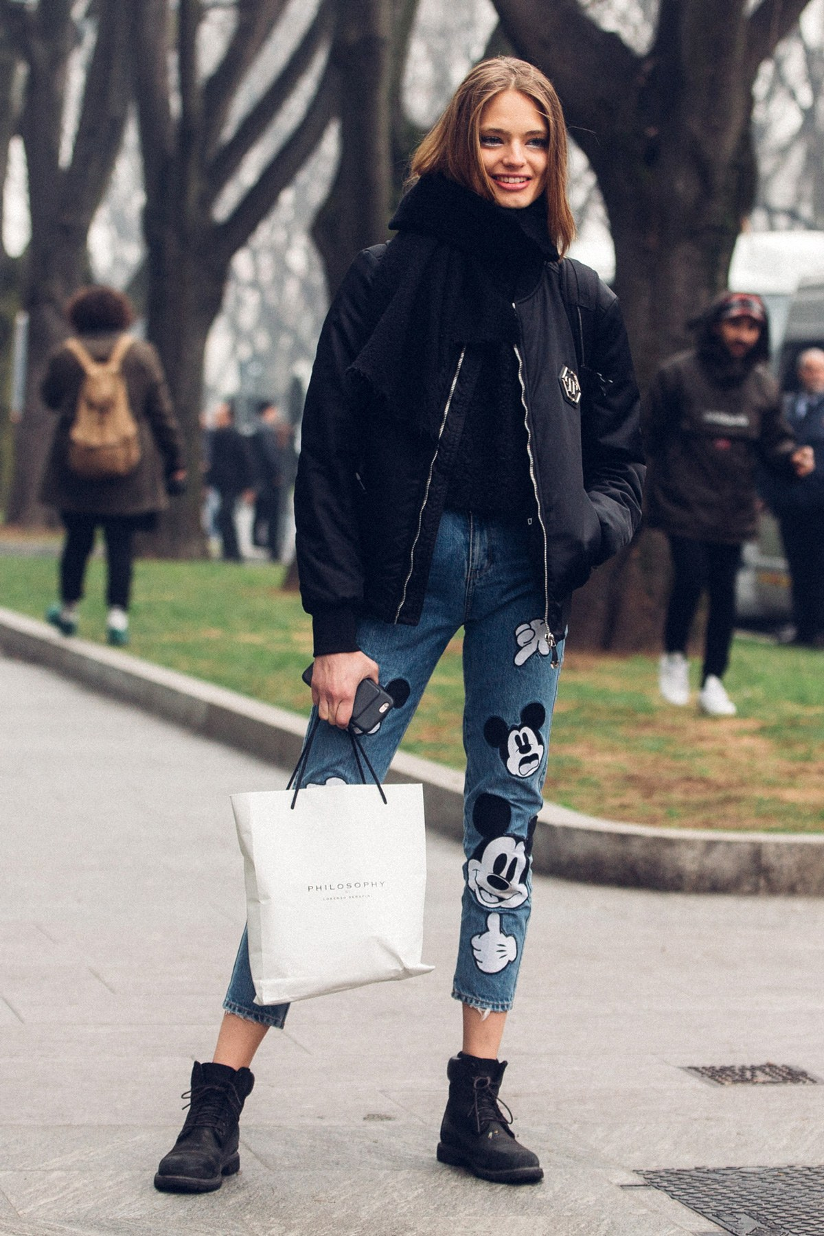 pA model wearing Mickey Mouse jeans during Fashion Week.p