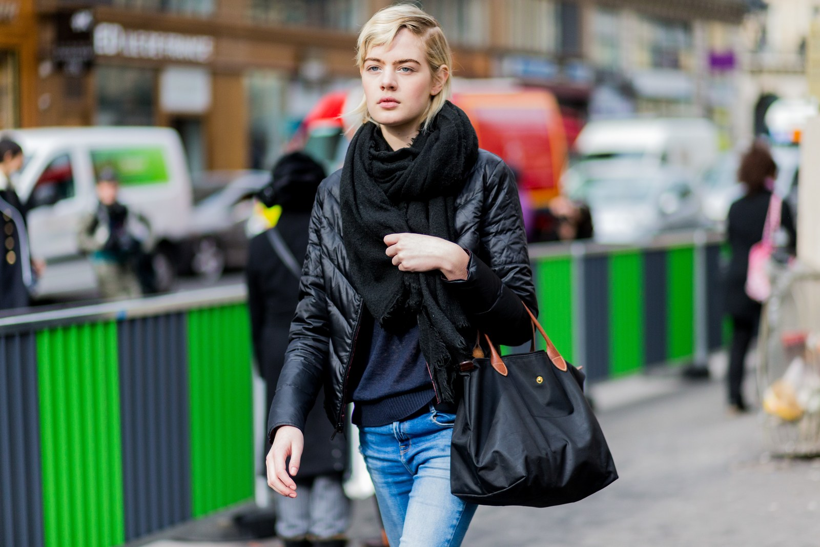 pA model carrying Longchamp's Le Pliage after a fashion show in 2016.p