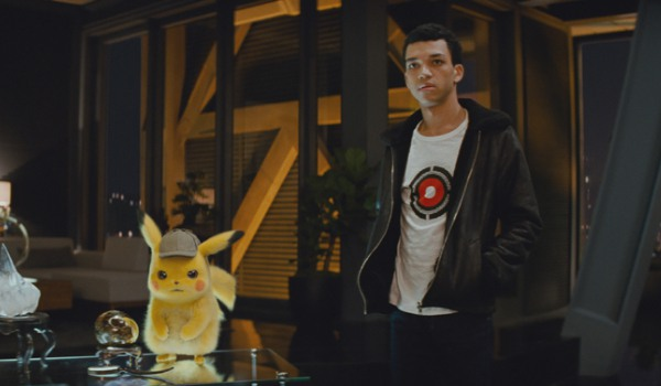Detective Pikachu and Tim listening intently in Clifford's office
