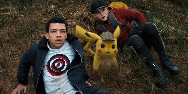 Detective Pikachu Tim Pikachu and Lucy look up at the incoming threat