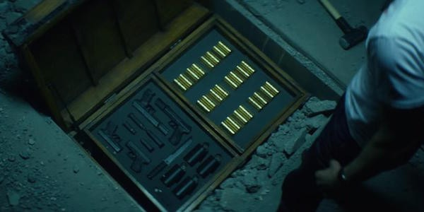 John Wick gold coins in briefcase