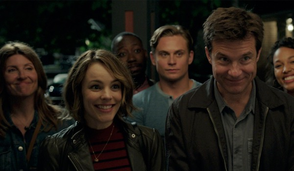 Game Night Rachel McAdams and Jason Bateman standing outside with their group of friends, smiling aw