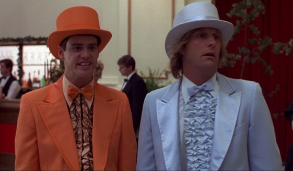 Dumb and Dumber Harry and Lloyd stand in their odd colored tuxes, admiring the ladies