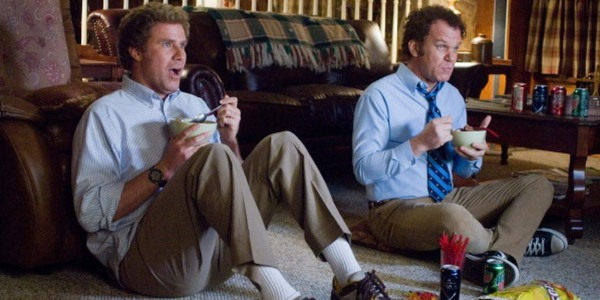 Step Brothers Dale and Brennan watching TV while eating snacks
