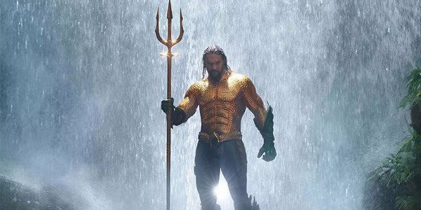 Jason Mamoa as Aquaman aided by the Trident of Neptune