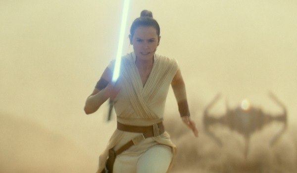 Rey running from a Tie fighter in Star Wars: The Rise Of Skywalker