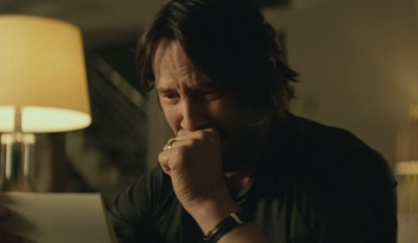 Keanu Reeves as John Wick crying
