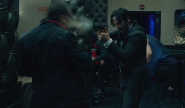 John Wick shooting somebody in the head