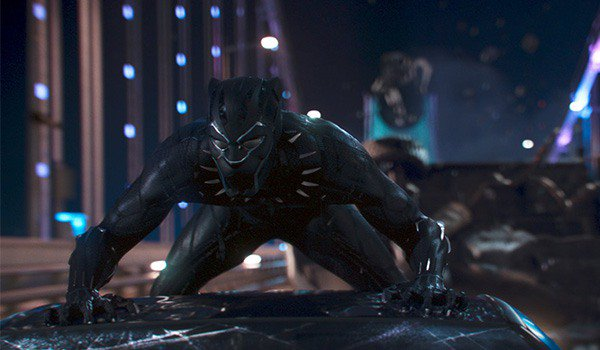 Chadwick Boseman as Black Panther in battle with his Vibranium suit