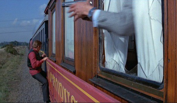 James Bond hangs from a train in Octopussy