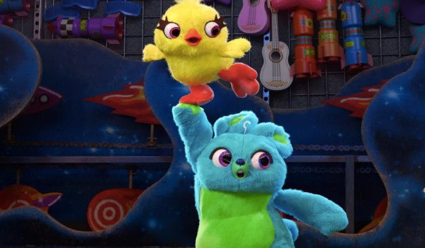 Toy Story 4 Ducky and Bunny make a run for it at the carnival game