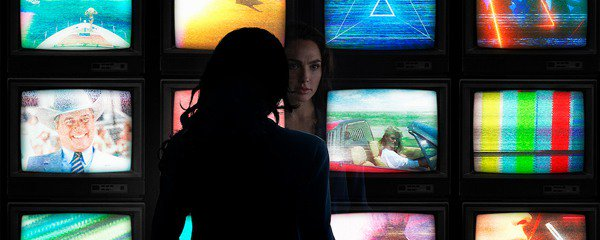 Wonder Woman 1984 Diana in front of monitors