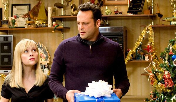Four Christmases cast still with present