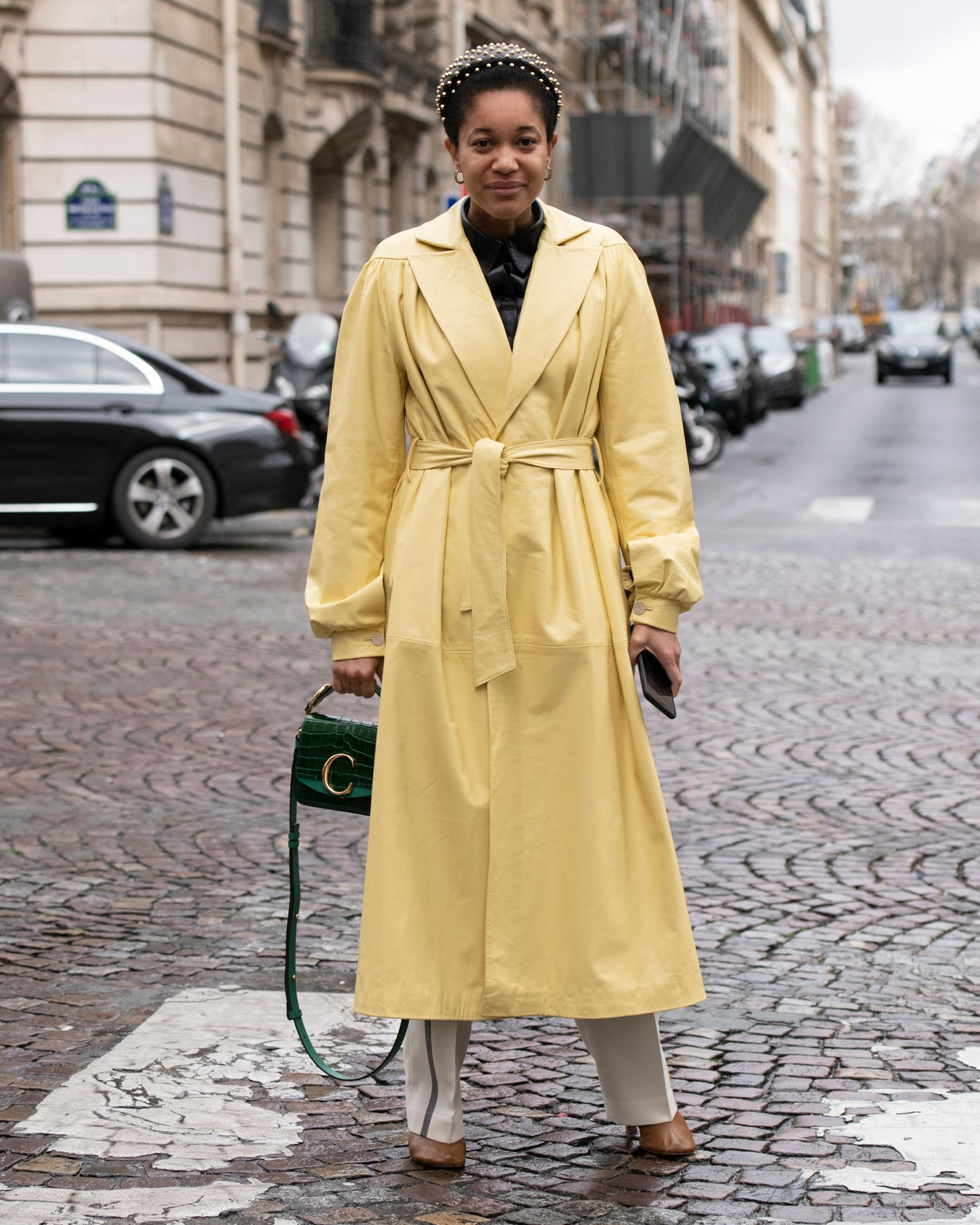 woman wearing a yellow wrap coat