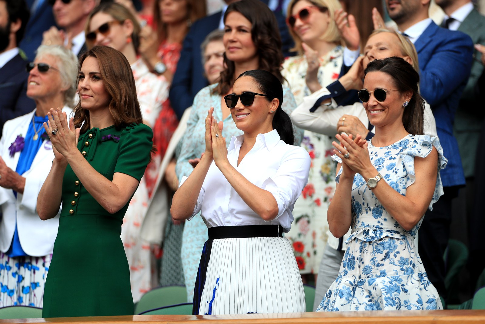 The Duchess of Cambridge and The Duchess of Sussex with Pippa Matthews on day twelve of the Wimbledon Championships at...