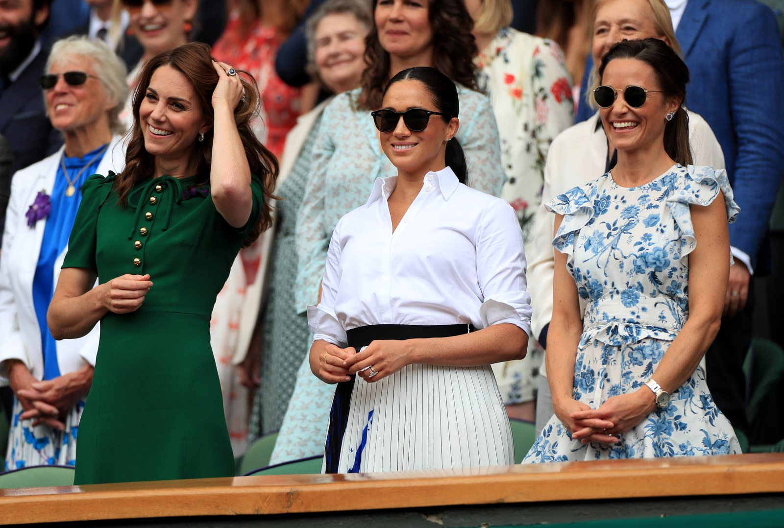 The Duchess of Cambridge and The Duchess of Sussex wit Pippa Middleton on day twelve of the Wimbledon Championships at...