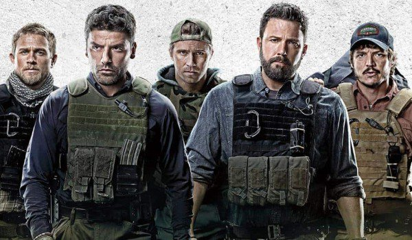 Triple Frontier cast lineup looking dangerous in front of a granite backgrounf