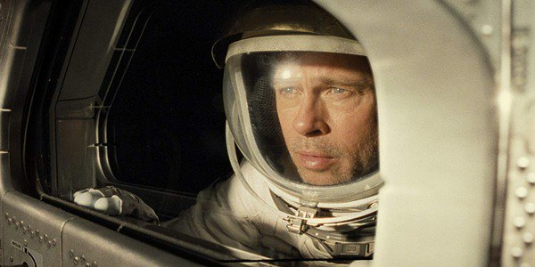Ad Astra Brad Pitt looks out the spaceship window