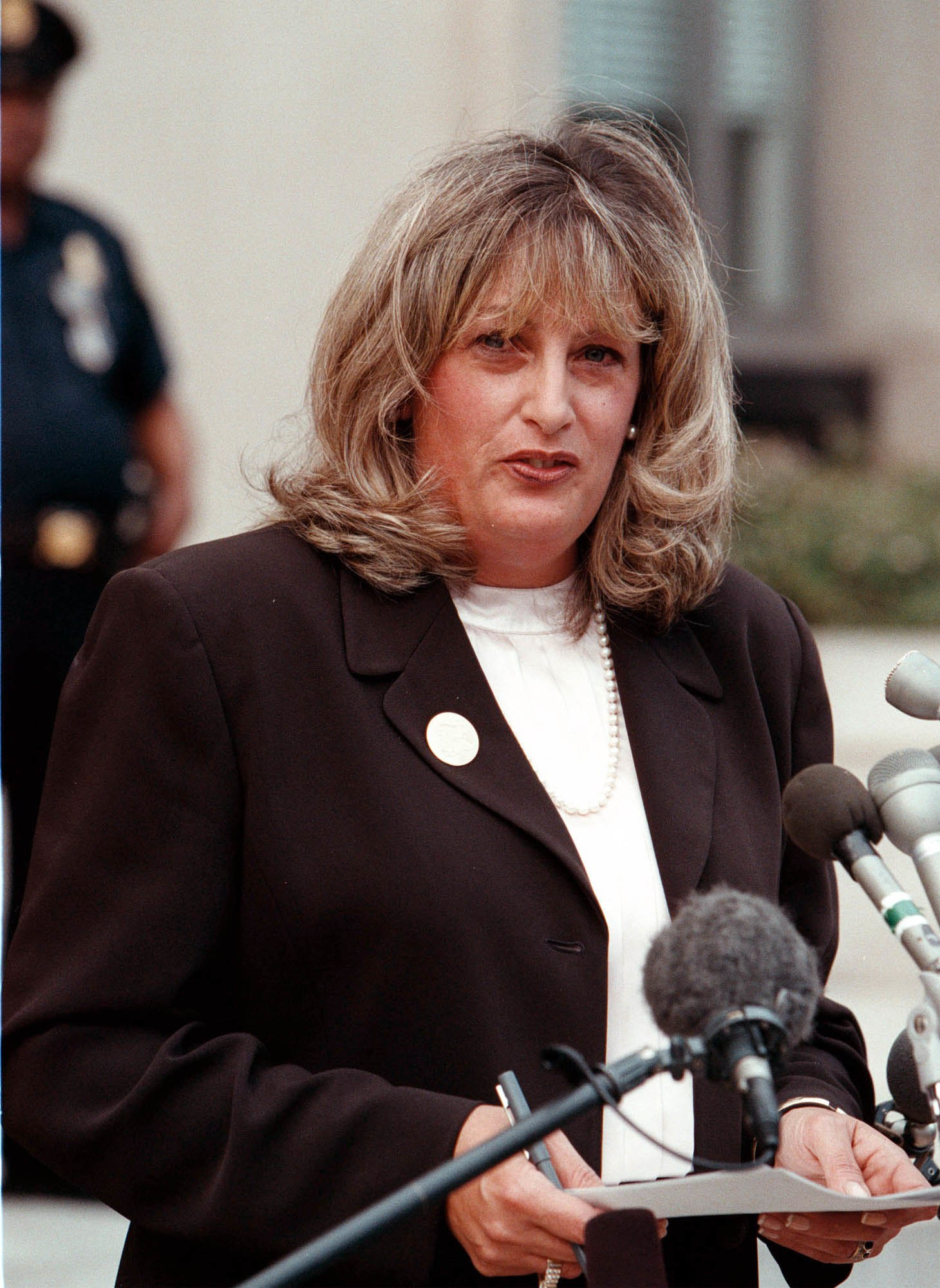 Linda Tripp talks to the press outside the Federal Courthouse July 29 1998 in Washington DC