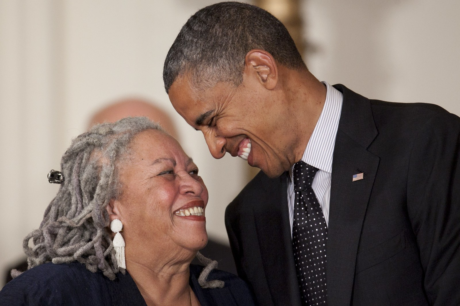 Novelist Toni Morrison laughs with U.S. President Barack Obama before being awarded the Presidential Medal of Freedom