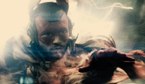 Batman v. Superman: Dawn of Justice The Flash glowing in a Boom Tube, with an important warning