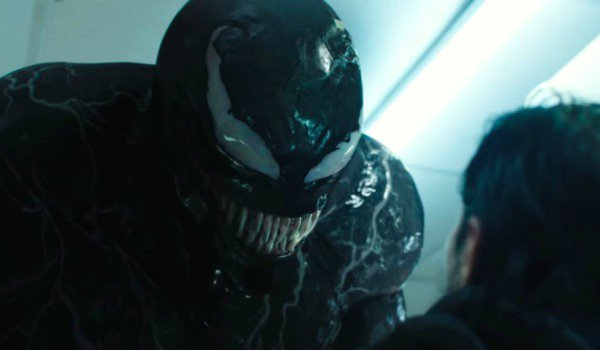 Venom about to eat a man in a convenience store