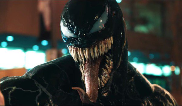 Venom with his tongue out, ready to eat a man's head off