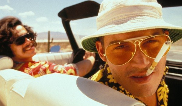 Fear and Loathing In Las Vegas Benicio del Toro and Johnny Depp stare at you with crazed looks