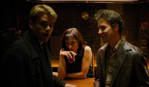Rounders Matt Damon and Edward Norton chat in front of Famke Janssen