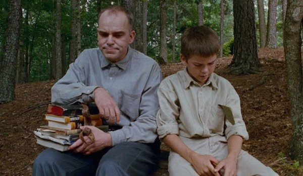 Sling Blade Billy Bob Thornton sits with a kid in the woods