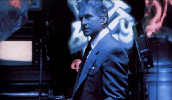 The Game Michael Douglas bathed in blue light, holding a gun