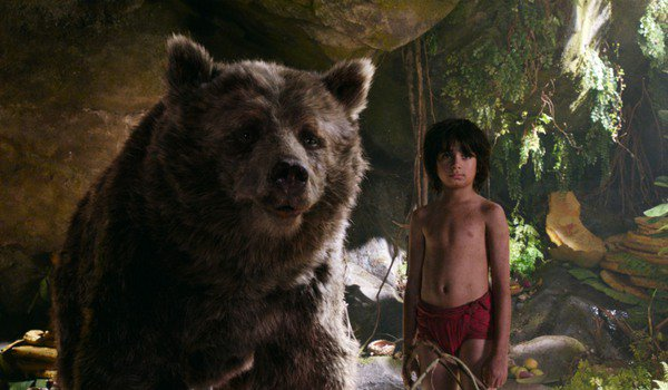 The Jungle Book Mowgli and Baloo standing in the shade of some rocks