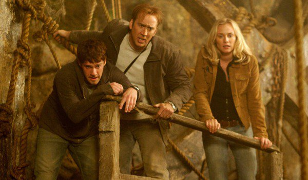 National Treasure Nicolas Cage and his team lean on a railing