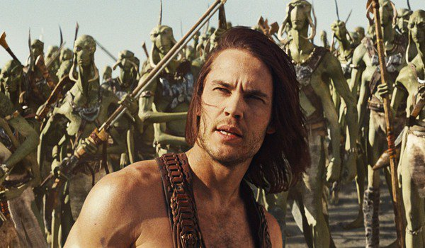 John Carter stands in front of a bunch of Tharks