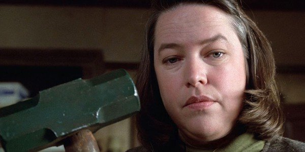 Annie Wilkes holds her sledgehammer in Misery