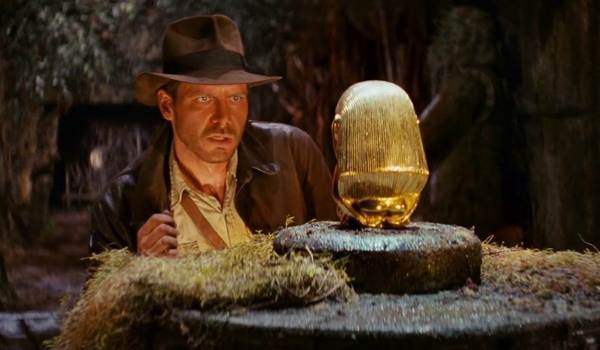 Raiders of the Lost Ark Indiana Jones contemplates taking the statue in the cave