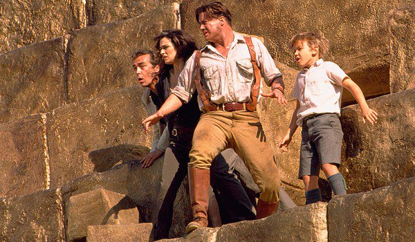 The Mummy Returns Jonathan, Evelyn, Rick, and Alex perched on a pyramid's ledge
