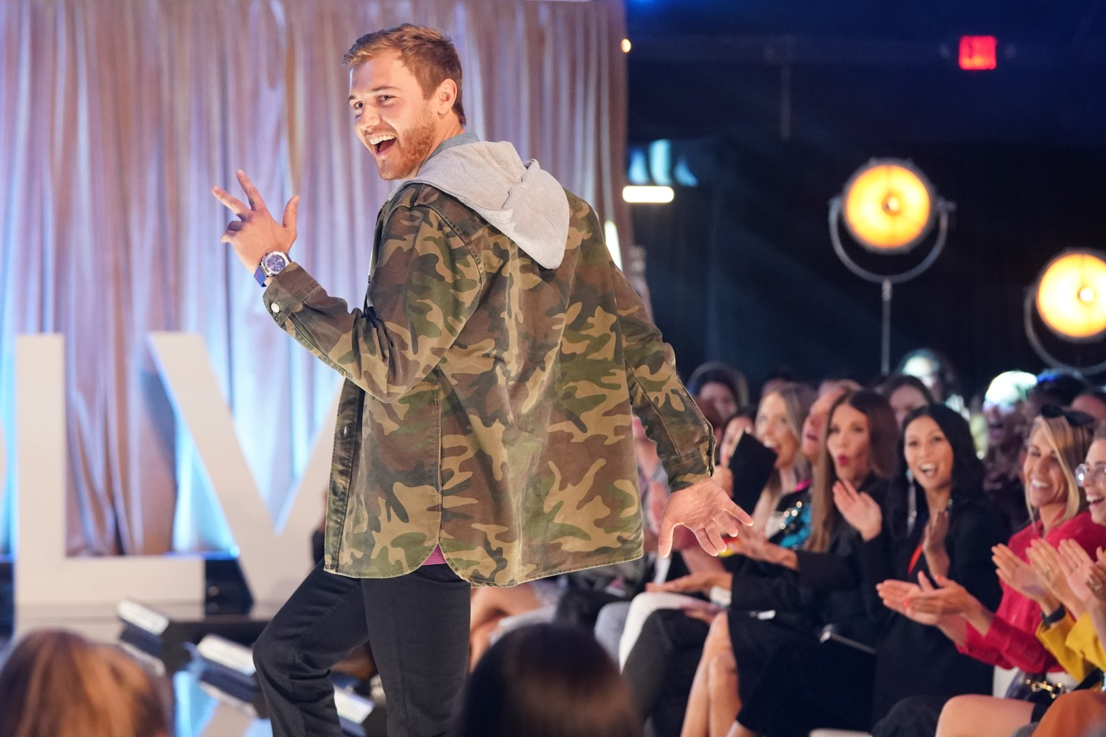Peter Weber walks the runway at fashion show on The Bachelor