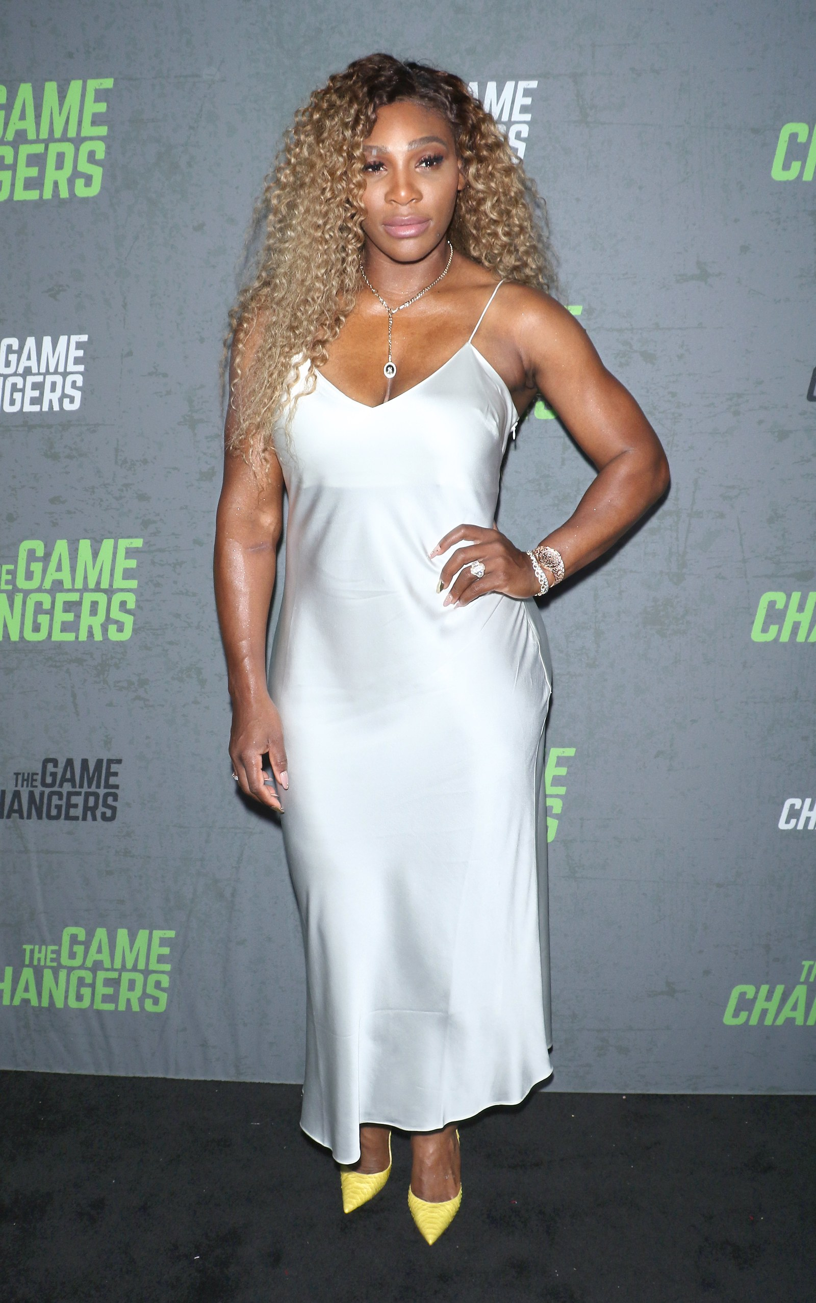 Serena Williams outfit Serena Williams wears a slip dress to a TV premiere