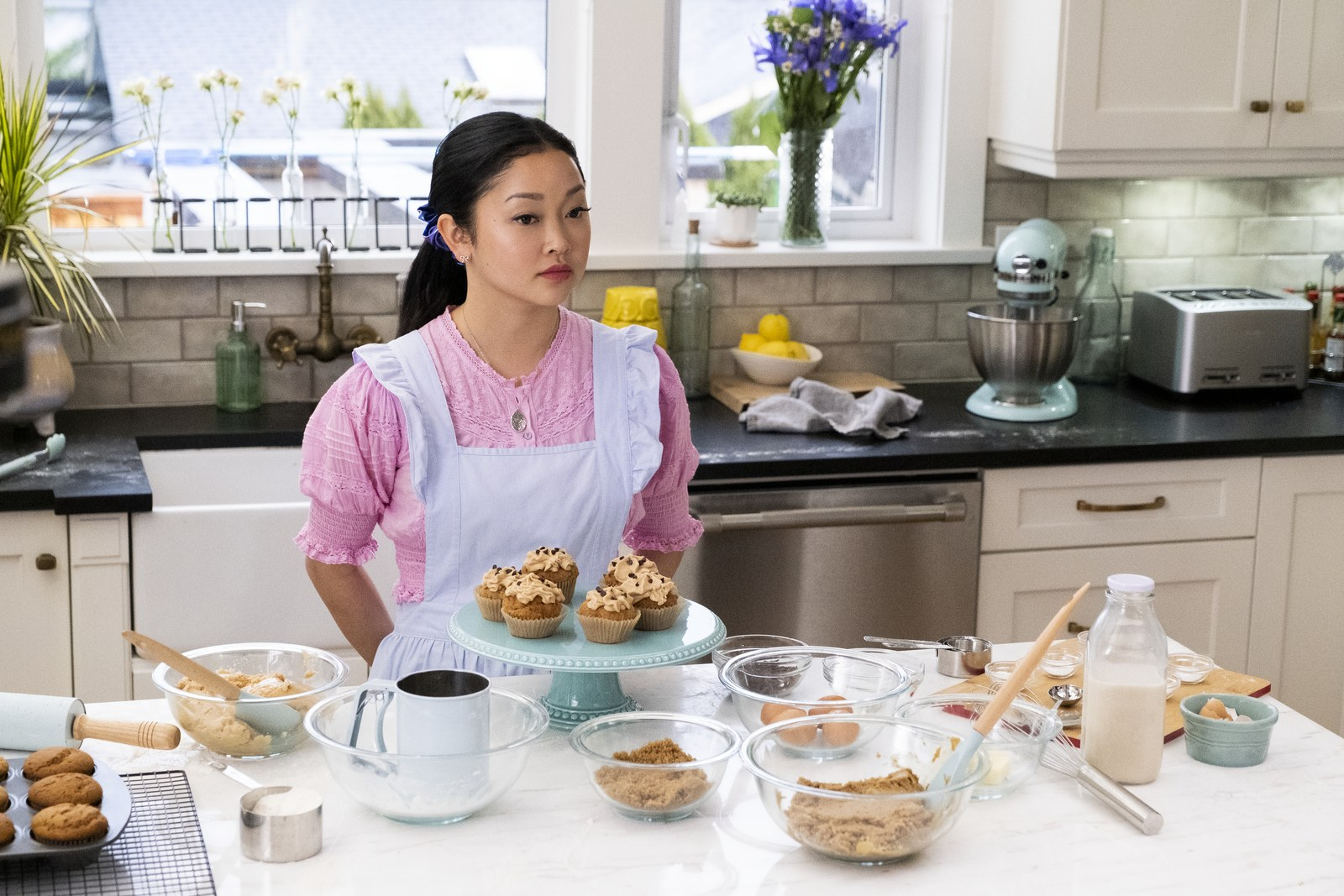 Lara Jean bakes cupcakes in a kitchen