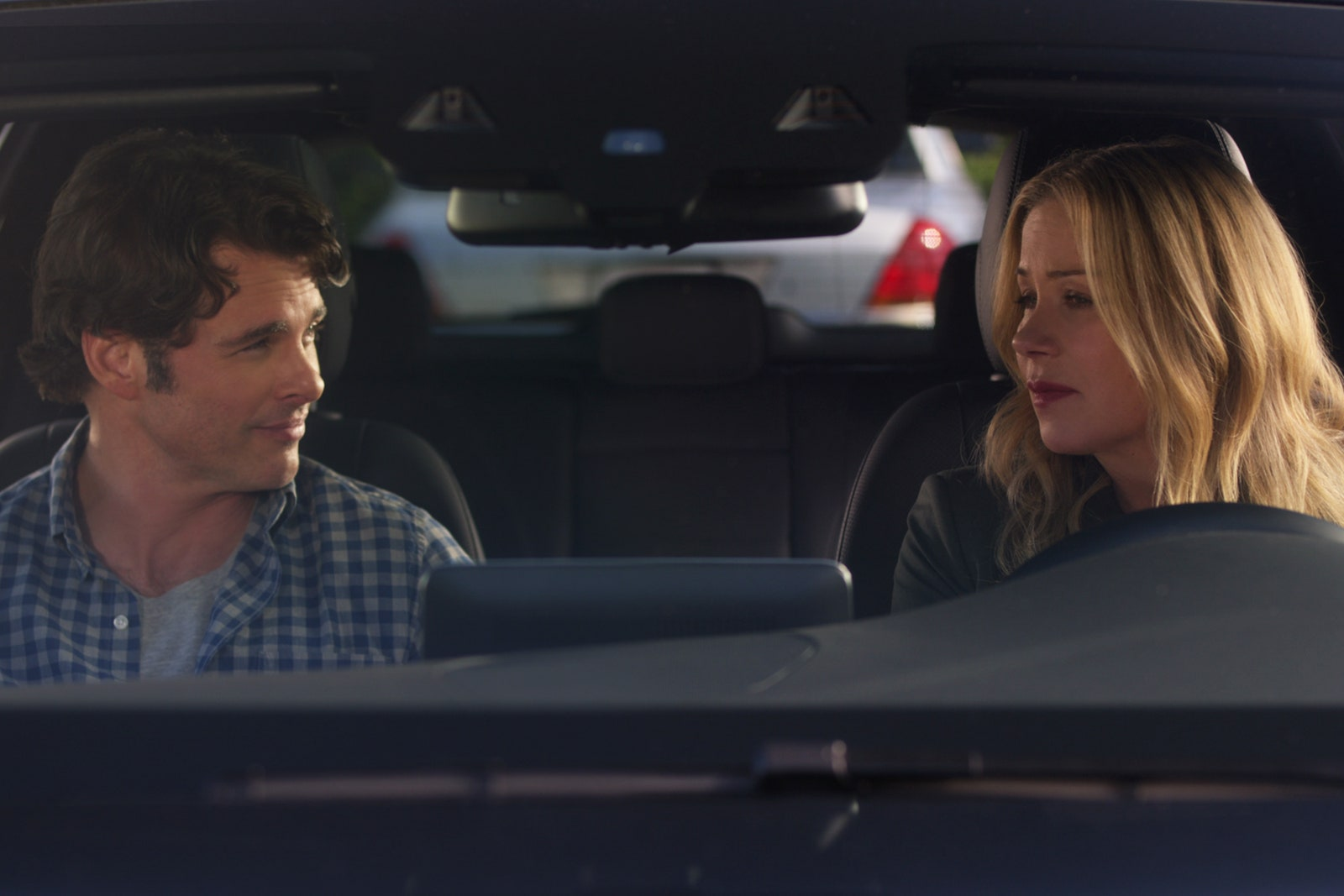 Jen and Ben in the car talking
